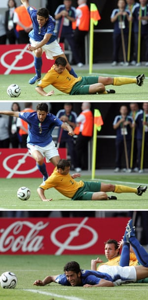 Fabio Grosso falls after fighting for the ball with Australian defender Lucas Neill.