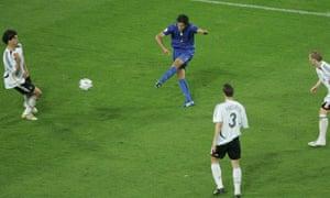 Fabio Grosso curls the ball into the net.