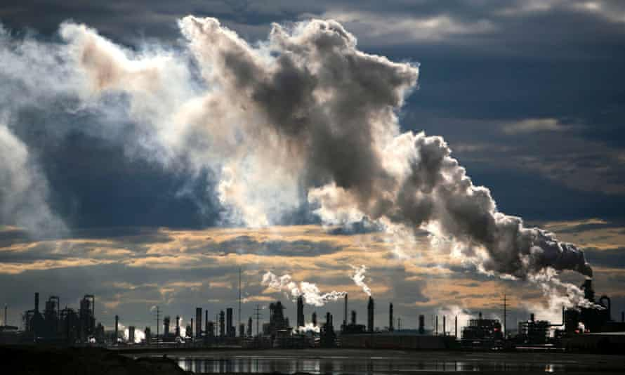 View of smoke plumes emitted from the Syncrude upgrader plant north of Fort McMurray, northern Alberta, Canada.