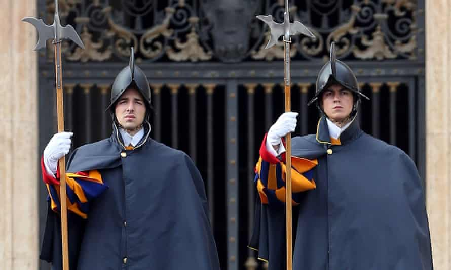Swiss Guards attend the pope's weekly audience in St Peter's Square.