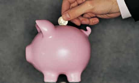 Piggy bank and coins on calendar