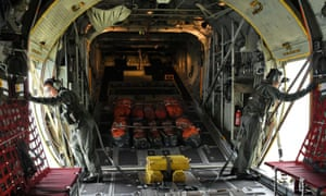 Singapore air force personnel on a C-130 aircraft take part in the search operation.