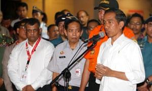 Indonesian president Joko Widodo talks to the media in Surabaya after meeting relatives of the missing AirAsia plane passengers.