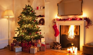 Christmas tree with gifts roaring fire