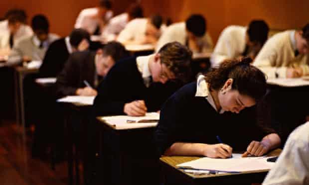Schoolboys and girls sitting GCSE exams.