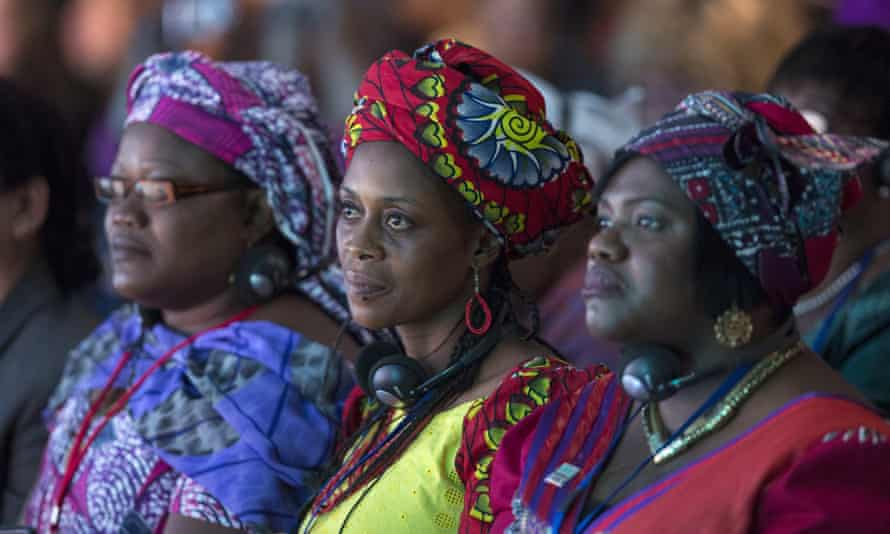 Delegates at a summit in London listen to discussions about how to prevent female genital mutilation.