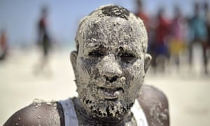 A man enjoys a day out on Mogadishu's Lido beach, which has become so popular again that lifeguards have been deployed.