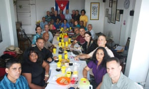 Group of Cuban dissidents hold meeting in office of 14ymedio, the online newspaper of blogger Yoani Sanchez (fourth from right) in Havana on 22 December in this unverified handout photo.<br>