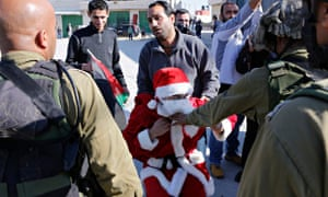 Palestinian protester dressed in a Santa Claus