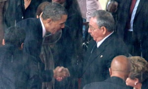 Barack Obama and Raul Castro shake hands at Nelson Mandela's funeral in December 2013.