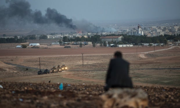 A man watches US airstrikes aimed at Isis forces