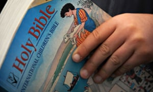 A child reading a children's bible
