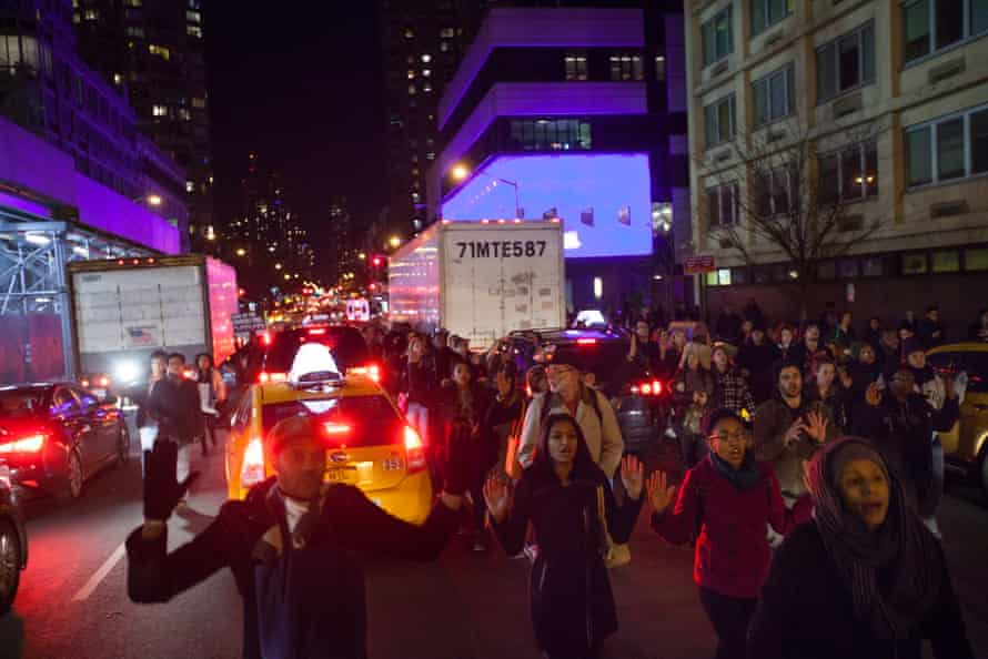 People march though traffic on 10th Avenue in New York