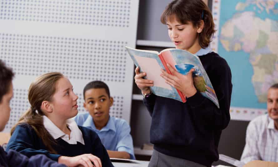 Group of children reading in school
