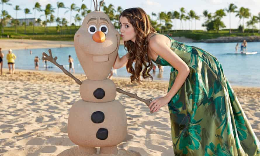 Austin & Ally star Laura Marano is photographed on the beach at Aulani, a Hawaii Disney Resort & Spa, during production of Disney Parks Frozen Christmas Celebration.
