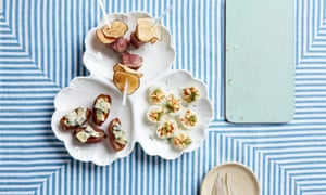 Canapes set out on a table: devilled quail eggs, medjool dates with crozier blue cheese, duck with jerusalem artichoke crisps