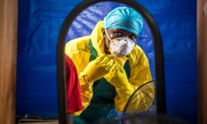 A healthcare worker prepares to enter an Ebola treatment centre west of Sierra Leone's capital Freetown