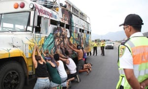 A bus carrying Ecuadorian environmental activists is stopped by police en route to Lima climate talks