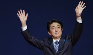 Japan s Prime Minister Shinzo Abe waves to members of the Japanese community during a meeting at the Brazilian Society of Japanese Culture, in Sao Paulo, Brazil.