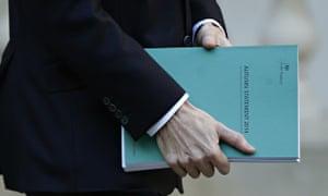 George Osborne carrying the autumn statement document