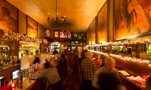 Tosca Cafe and its long, muralled bar