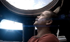 International Space station commander Chris Hadfield looks down at the Earth from orbit.