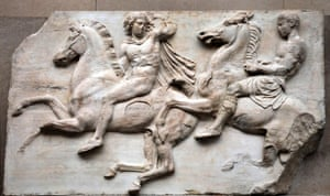 A detail of a frieze shows men exercising their horses