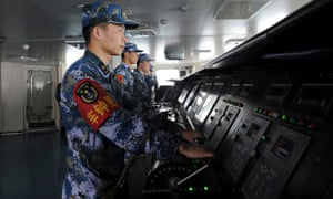 Chinese naval soldiers man their stations on China's aircraft carrier Liaoning
