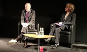 Seymour Hersh and Laura Flanders on stage at the Logan Symposium.
