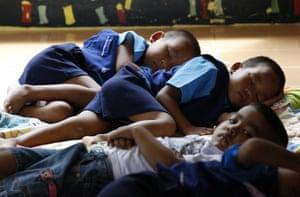 Boys lie on the floor for an afternoon sleep
