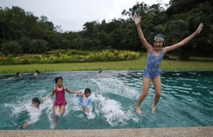 Children play in the swimming pool