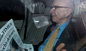 Rupert Murdoch with a copy of the Times