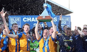 Adam Murray lifts the trophy as Mansfield celebrate winning the Blue Square Bet Premier in April 2013. Photograph: Ross Kinnaird/Getty Images