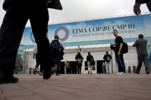 People arrive to the Climate Change Conference in Lima, Peru, Monday, Dec. 1, 2014. Delegates from more than 190 countries will meet in Lima for two weeks to work on drafts for a global climate deal that is supposed to be adopted next year in Paris.