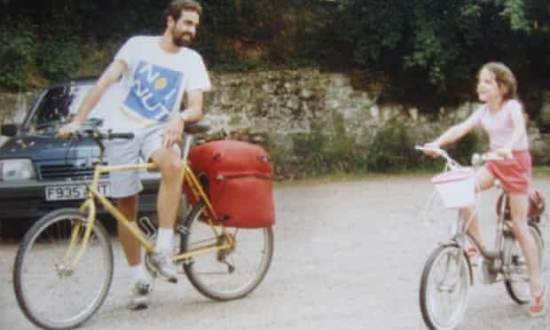 Emilly Chappell on a camping trip with her father and pink step-through bicycle.