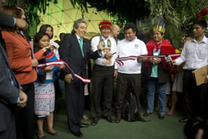 Peru's Minister of Environment and President of the COP 20, Manuel Pulgar Vidal (L) and Alberto Pizango (C), indigenous leader of the Alternative Alliance for Humanity (APHU), inaugurate the Indigenous Pavilion on the sidelines of the UN COP20 and CMP10 conference in Lima, on December 2, 2014. The UN 20th session of the Conference of the Parties on Climate Change and the 10th session of the Conference of the Parties serving as the Meeting of the Parties to the Kyoto Protocol is being held from December 1st to 12th in Lima.