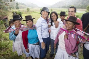 A photo made available by the International Monetary Fund shows IMF Managing Director Christine Lagarde (L), Perus First Lady Nadine Heredia (C) and Minister of Economy and Finance of Peru Alonso Segura Vasi (R) posing with local inhabitants during a tour of their community of Ayacucho , southeast of Lima on December 3, 2014.