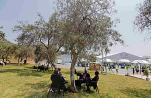 Participants are seated in the garden of the venue of the U.N. Climate Change Conference COP 20 in Lima December 2, 2014. A two-week long United Nations climate summit opened on December 1 in Lima, with experts and analysts from around the world gathering to discuss melting glaciers and extreme weather patterns.
