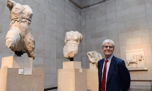 Sir Richard Lambert, chairman of the British Museum Trustees, poses next to the Parthenon marbles in the British Museum, London.