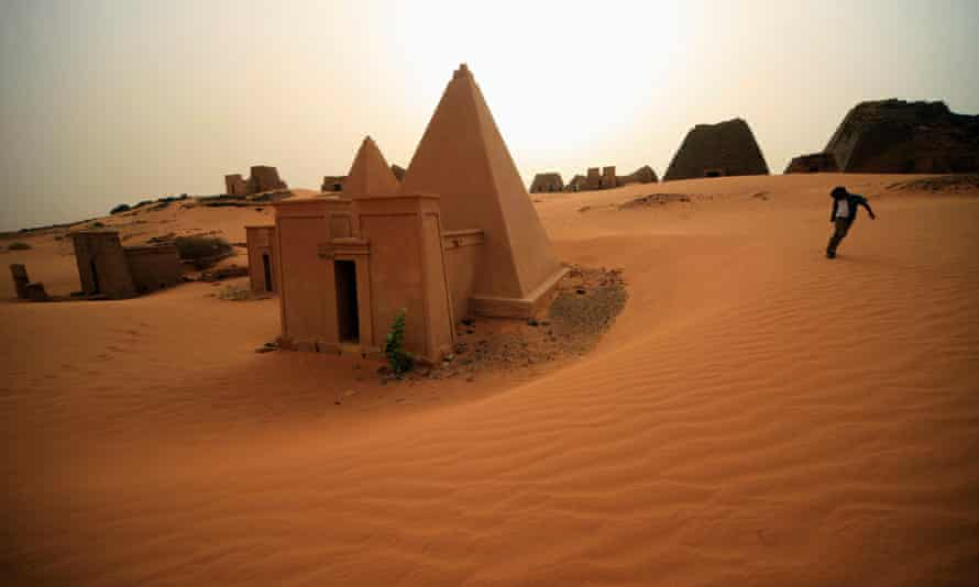 A boy plays near the site of 44 Nubian pyramids of kings and queens in the ruins of the ancient city of Meroe at Begrawiya in Sudan