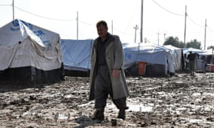 An Iraqi refugee, having fled his home along with many others due to the violence of armed groups le
