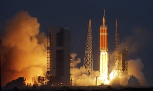 Nasa's Orion spacecraft, atop a United Launch Alliance Delta 4-Heavy rocket, lifts off on its first unmanned orbital test flight.
