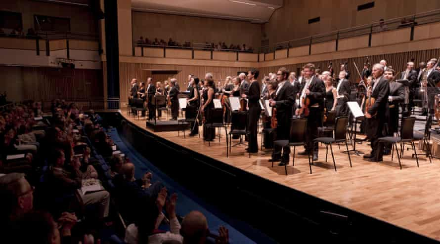 The London Philharmonic Orchestra take a bow after the first performance at Saffron Hall in Saffron Walden, Essex.