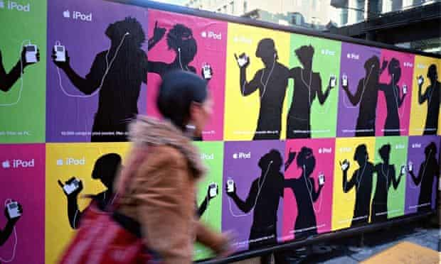 Adverts for the Apple iPod cover a wall in New York