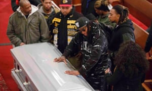 Friends of Akai Gurley stand by his coffin during his wake at Brown Memorial Baptist Church in Brooklyn.