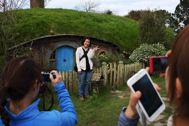 Tourists on the set of Hobbiton.