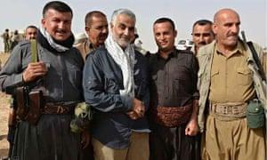 Qassem Suleimani with a group of peshmerga fighters in Kurdistan