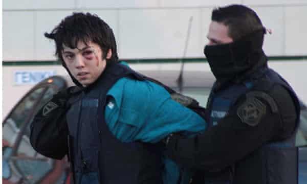 Nikos Romanos being arrested.