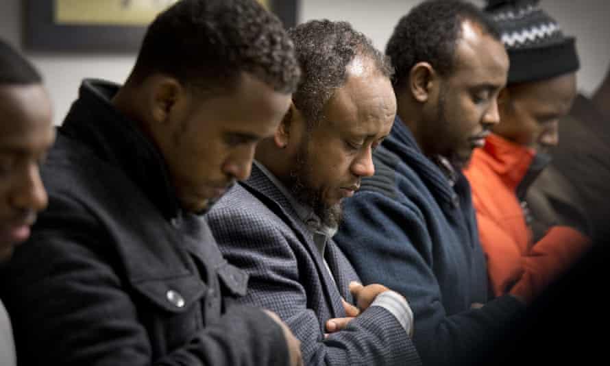 Men gather to pray