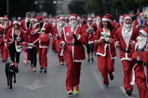 A dog joins in the first Athens Santa Claus Run